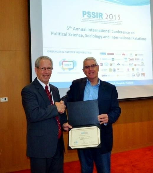 Prof. the Hon. Dr. Stephen Martin, chair of the Board of Governors of the Global Science & Technology Forum, which organized the conference, presented the award to Dr. Rosenberg, who accepted on behalf of his co-authors.